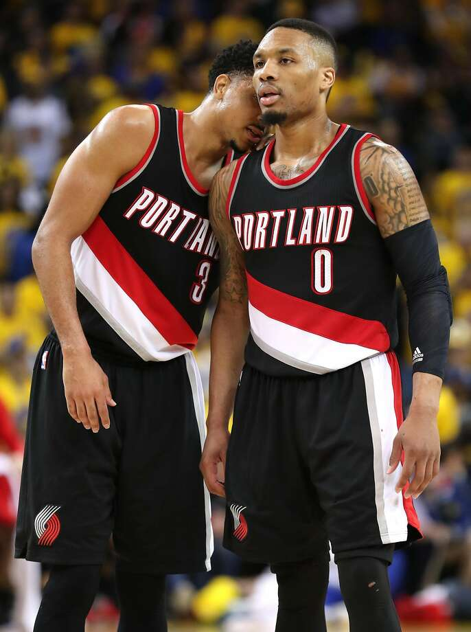 Portland Trail Blazers' Damian Lillard (0) and C.J. McCollum confer late in 4th quarter of 121-109 loss to Golden State Warriors in Game 1 of NBA Western Conference 1st Round Playoffs at Oracle Arena in Oakland, Calif., on Sunday, April 16, 2017. Photo: Scott Strazzante, The Chronicle