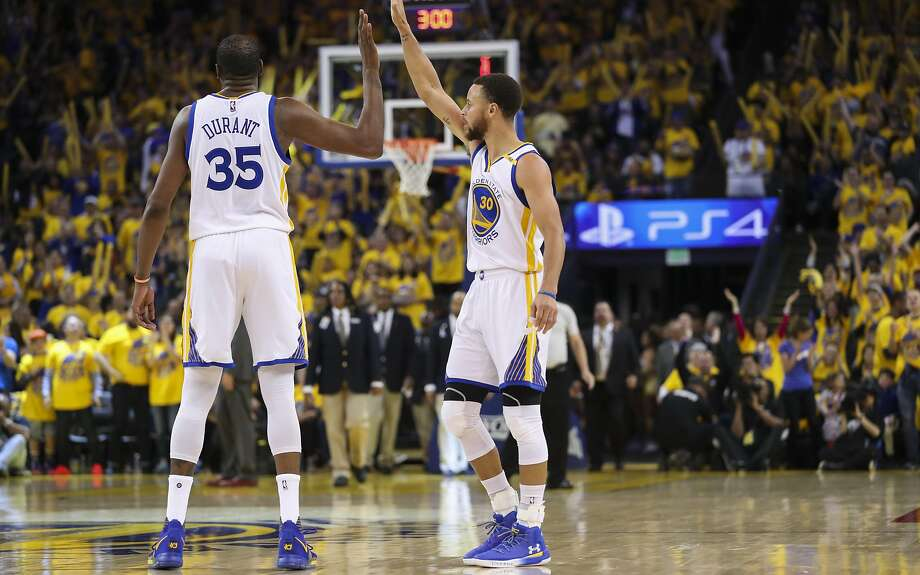 Golden State Warriors' Kevin Durant and Stephen Curry high five in the third quarter during Game 1 of the First Round of the Western Conference 2017 NBA Playoffs at Oracle Arena on Sunday, April 16, 2017 in Oakland, Calif. Photo: Scott Strazzante, The Chronicle