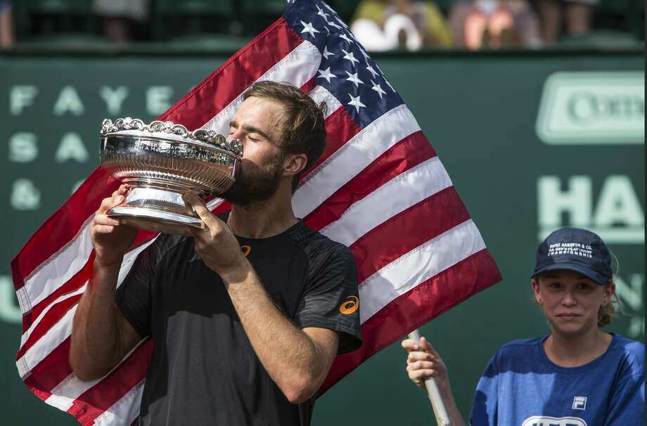 Steve Johnson kisses the championship trophy after beating Thomaz Bellucci in the championship singles match of the Fayez Sarofim & Co. U.S. Men's Clay Court Championship at River Oaks Country Club on Sunday, April 16, 2017, in Houston. Johnson beat Bellucci, of Brazil, 6-4, 4-6, 7-6 (5), to take the title. ( Brett Coomer / Houston Chronicle ) Photo: Brett Coomer/Houston Chronicle