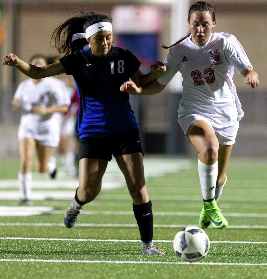 Porter midfielder Kimberly Rodriguez (23) battles for the ball against New Caney defenseman Monica Garcia (18) during the second period of a District 20-5A high school girls soccer match at Texan Drive Stadium Tuesday, Feb. 28, 2017, in New Caney. Porter defeated New Caney 3-0. Photo: Jason Fochtman, Staff Photographer / © 2017 Houston Chronicle