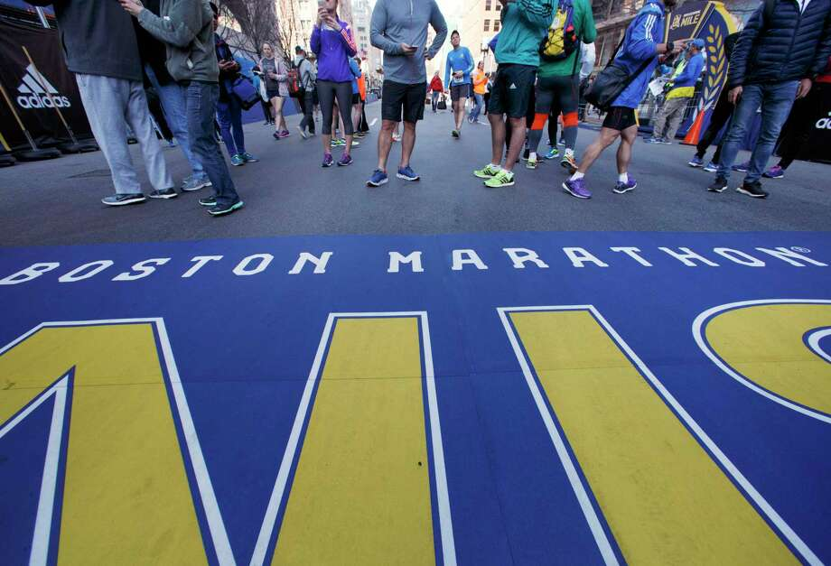 People gather at the Boston Marathon finish line, Saturday in Boston. The 121st running of the marathon takes place on Monday. Photo: Michael Dwyer, STF / Copyright 2017 The Associated Press. All rights reserved.