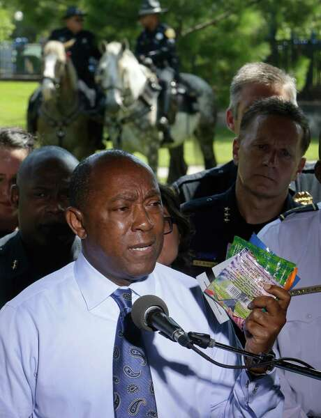 Mayor Sylvester Turner holds up Kush wrappers as he speaks during a media conference about the drug Kush held at Hermann Park Thursday, June 30, 2016, in Houston.  ( Melissa Phillip / Houston Chronicle ) Photo: Melissa Phillip, Staff / Stratford Booster Club