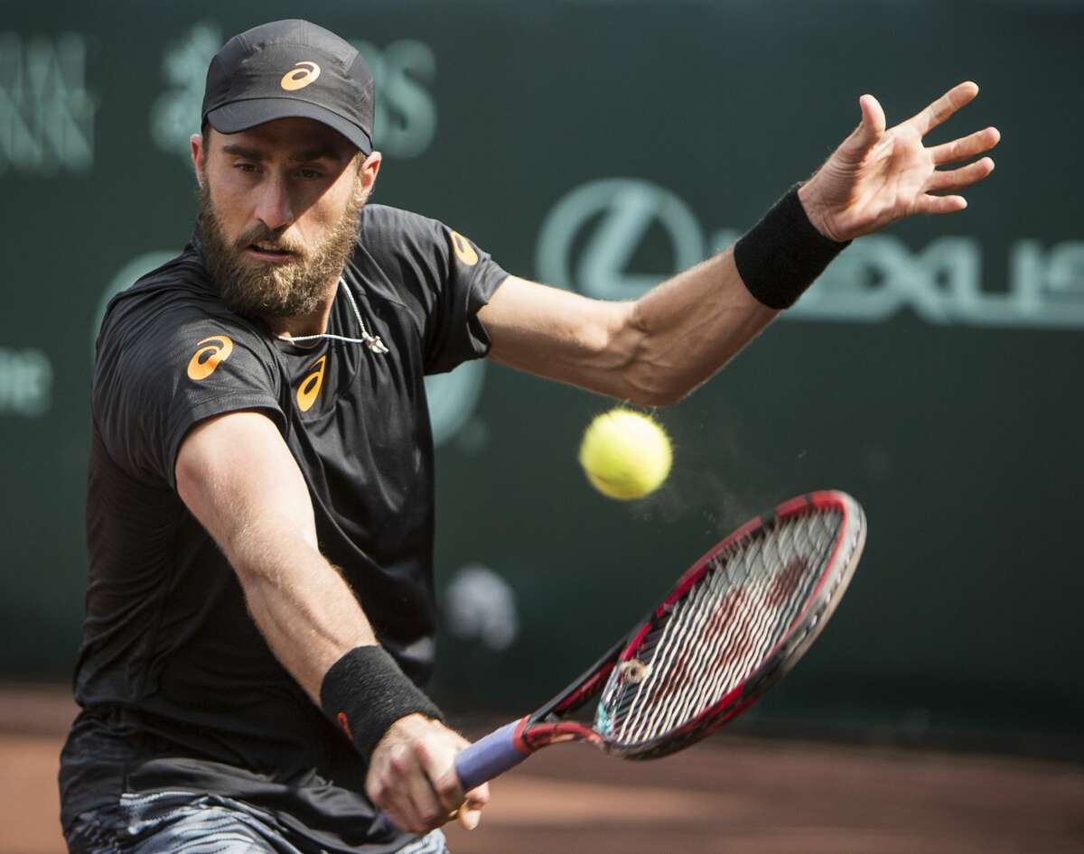 Steve Johnson hits a backhand against Thomaz Bellucci during final set of the championship singles match of the U.S. Men's Clay Court Championship tennis tournament at River Oaks Country Club on Sunday, April 16, 2017, in Houston. Johnson defeated Bellucci, of Brazil, 6-4, 4-6, 7-6 (5), to take the title. (Brett Coomer/ Houston Chronicle via AP)