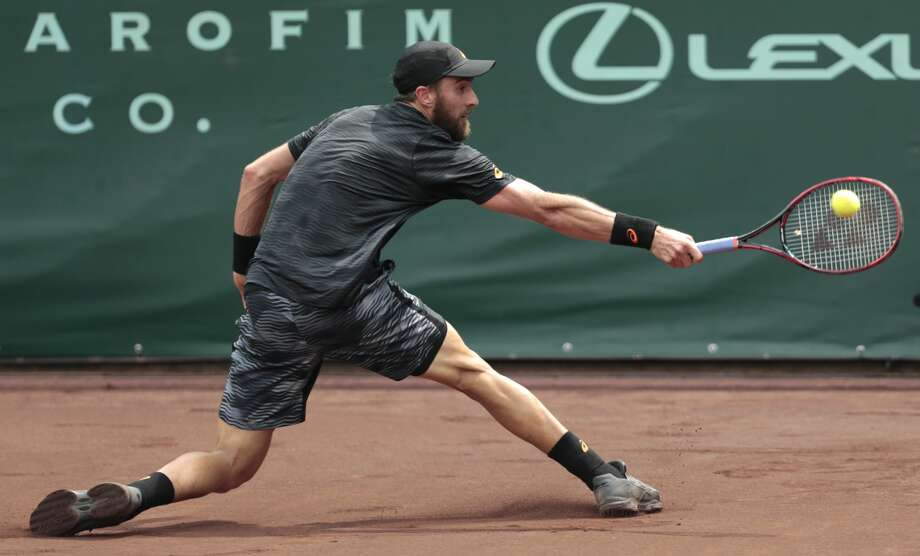 Steve Johnson reaches out to hit a backhand against Thomaz Bellucci during the championship singles match of the U.S. Men's Clay Court Championship tennis tournament at River Oaks Country Club on Sunday, April 16, 2017, in Houston. Johnson defeated Bellucci, of Brazil, 6-4, 4-6, 7-6 (5), to take the title. (Brett Coomer/ Houston Chronicle via AP) Photo: Brett Coomer/Associated Press