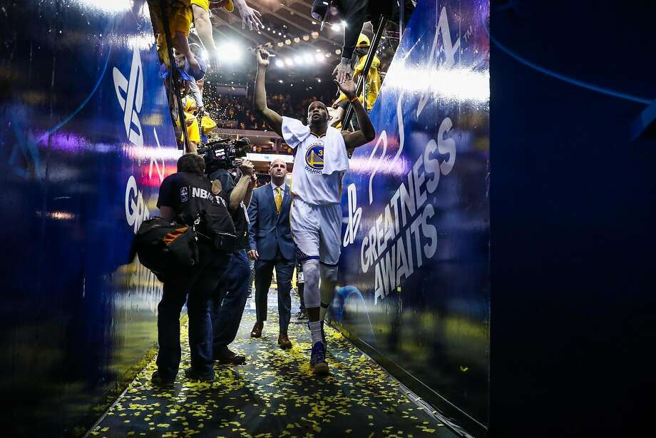 Kevin Durant (35) high-fives fans after an NBA playoffs game between the Golden State Warriors and the Portland Trailblazers in Oakland, California, on Sunday, April 16, 2017.Golden State Warriors defeated the Portland Trailblazers 121-109. Photo: Gabrielle Lurie, The Chronicle