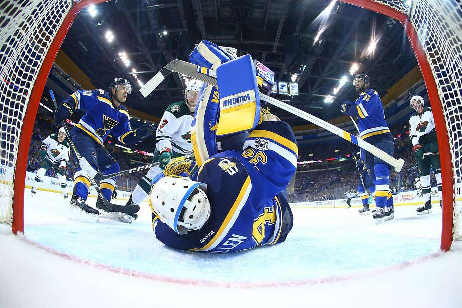 St. Louis goalie Jake Allen sprawls to make a save against Minnesota's Charlie Coyle (3). Allen made 40 saves and is the key to the Blues' 3-0 series lead. Photo: Dilip Vishwanat, Getty Images