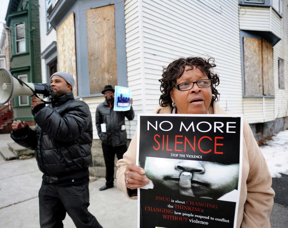 Beverly Padgett, chair of the Albany Community Policing Advising Committee, right, lends her voice to a Cure Violence, formerly SNUG, rally at the corner of North Lake Avenue and Second Street on Thursday, March 20, 2014, in Albany, N.Y. Joining her are program director Clarence Jackson, left, and community advocate Marlon Anderson. (Cindy Schultz / Times Union)
