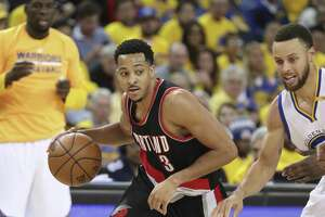 Portland Trailblazers'  CJ McCollum drives past Golden State Warriors' Stephen Curry in the second quarter during Game 1 of the First Round of the Western Conference 2017 NBA Playoffs at Oracle Arena on Sunday, April 16, 2017 in Oakland, Calif.