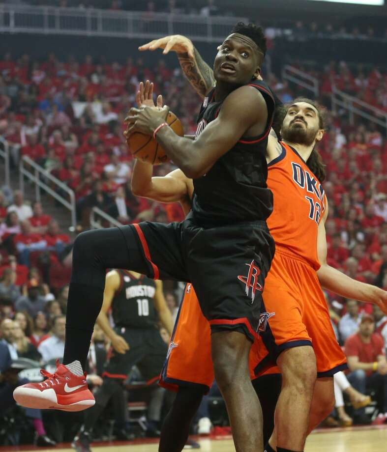 Houston Rockets center Clint Capela (15) gras a rebound against Oklahoma City Thunder center Steven Adams (12) during the first half of Game 1 of an NBA basketball first-round, Western Conference playoffs at the Toyota Center, Sunday April 16, 2017, in Houston. ( Karen Warren / Houston Chronicle ) Photo: Karen Warren/Houston Chronicle