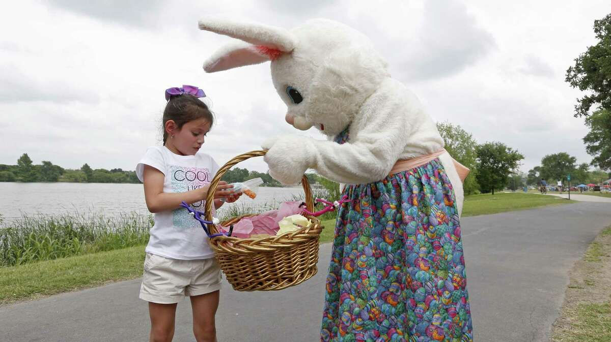 Nyshya Lopez, 6, receives candy from Virginia Salinas, 57, as the Easter Bunny, while enjoying Easter with her family at Woodlawn Lake Park last Sunday. A reader praises a recent column on the blessings of Easter - and life.