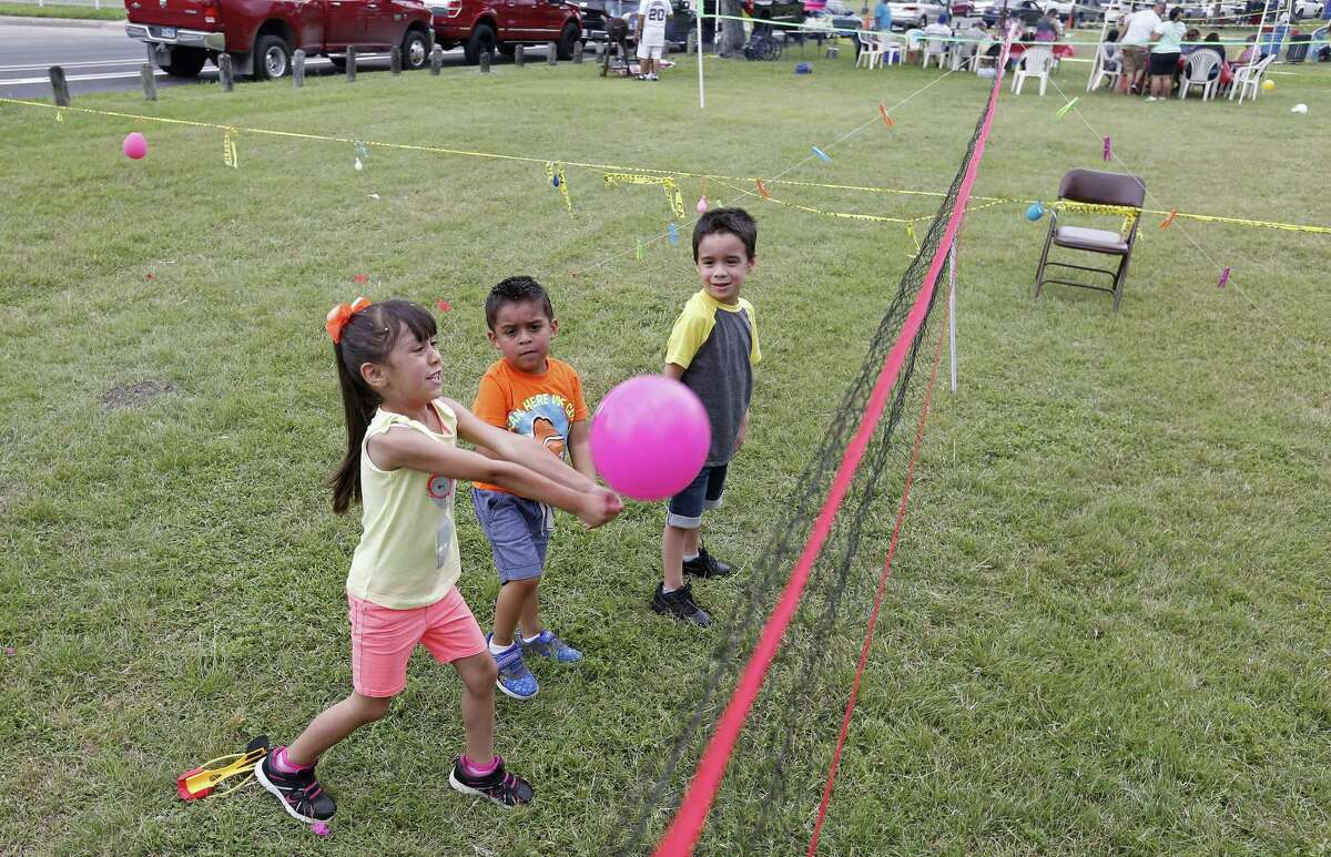 Giselle Hernandez, 5, (from left), Jacob Hernandez, 4, and Noah Zimmerle, 5, play volleyball while enjoying Easter with family at Woodlawn Lake Park Sunday April 16, 2017.