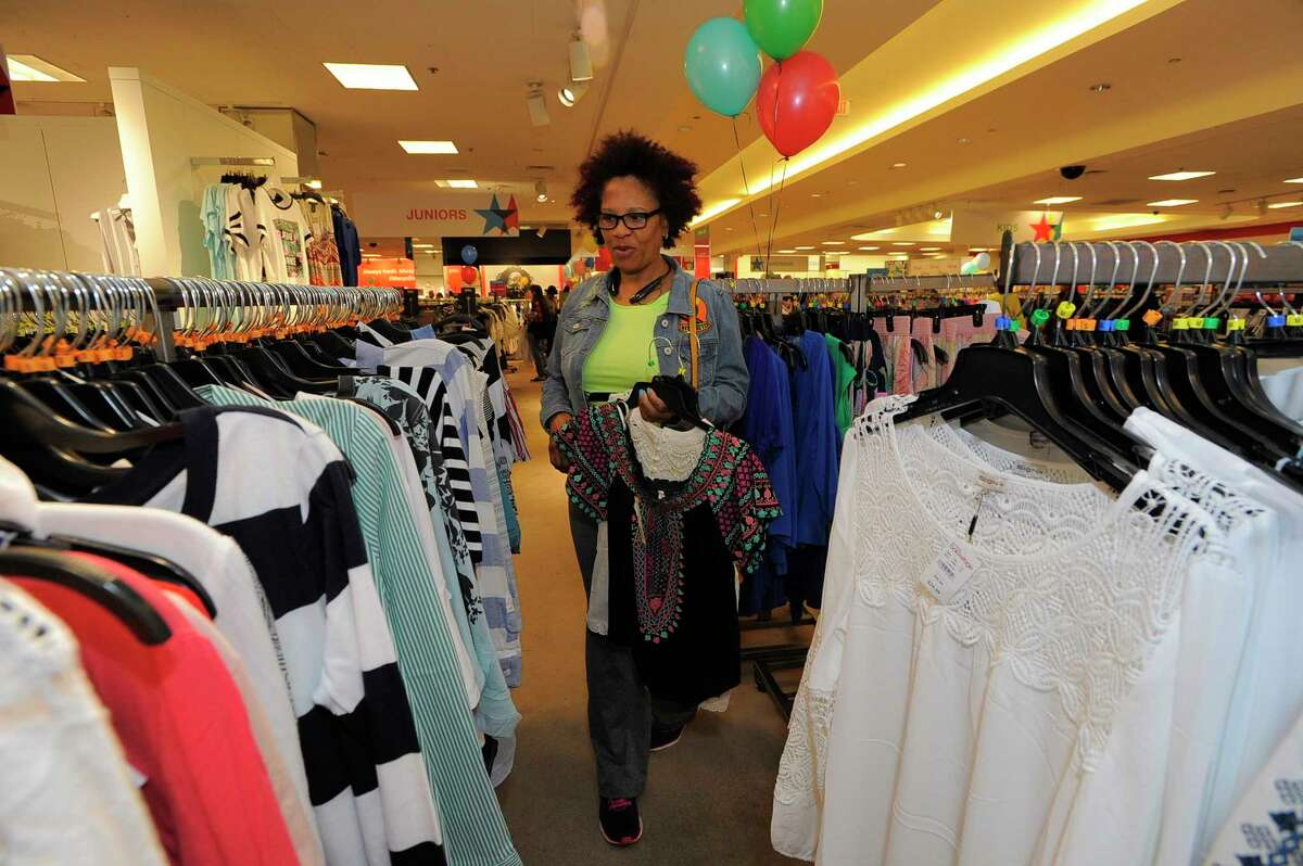 Donna Richards of Stamford shops for bargains as Macy's Backstage The Outlet Store opens at the Macy's Stamford Town Center on April 15, 2017.
