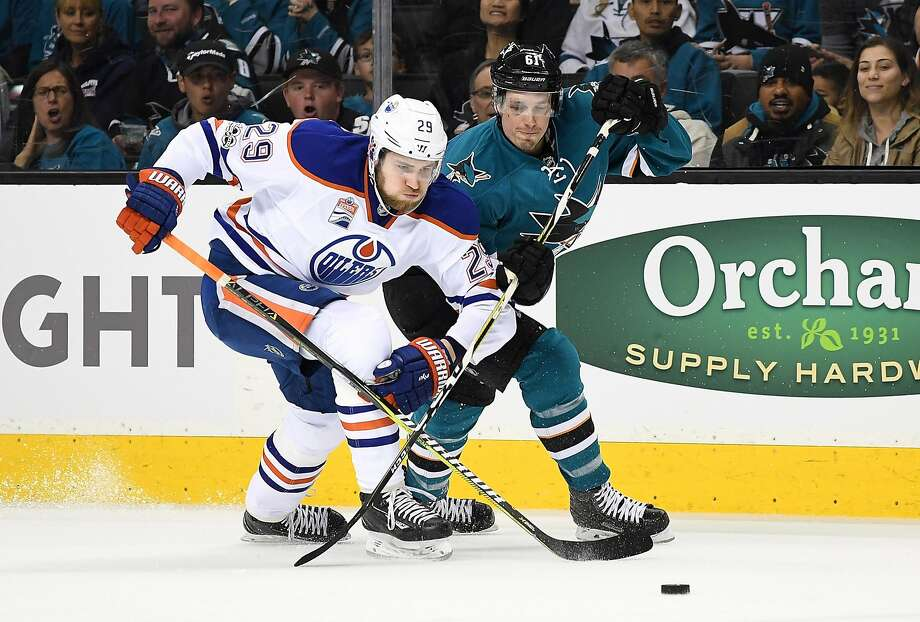 Leon Draisaitl of the Edmonton Oilers battles for control of the puck with Justin Braun of the San Jose Sharks during the first period in Game Three of the Western Conference First Round during the 2017 NHL Stanley Cup Playoffs at SAP Center on April 16, 2017 in San Jose, California. Photo: Thearon W. Henderson, Getty Images