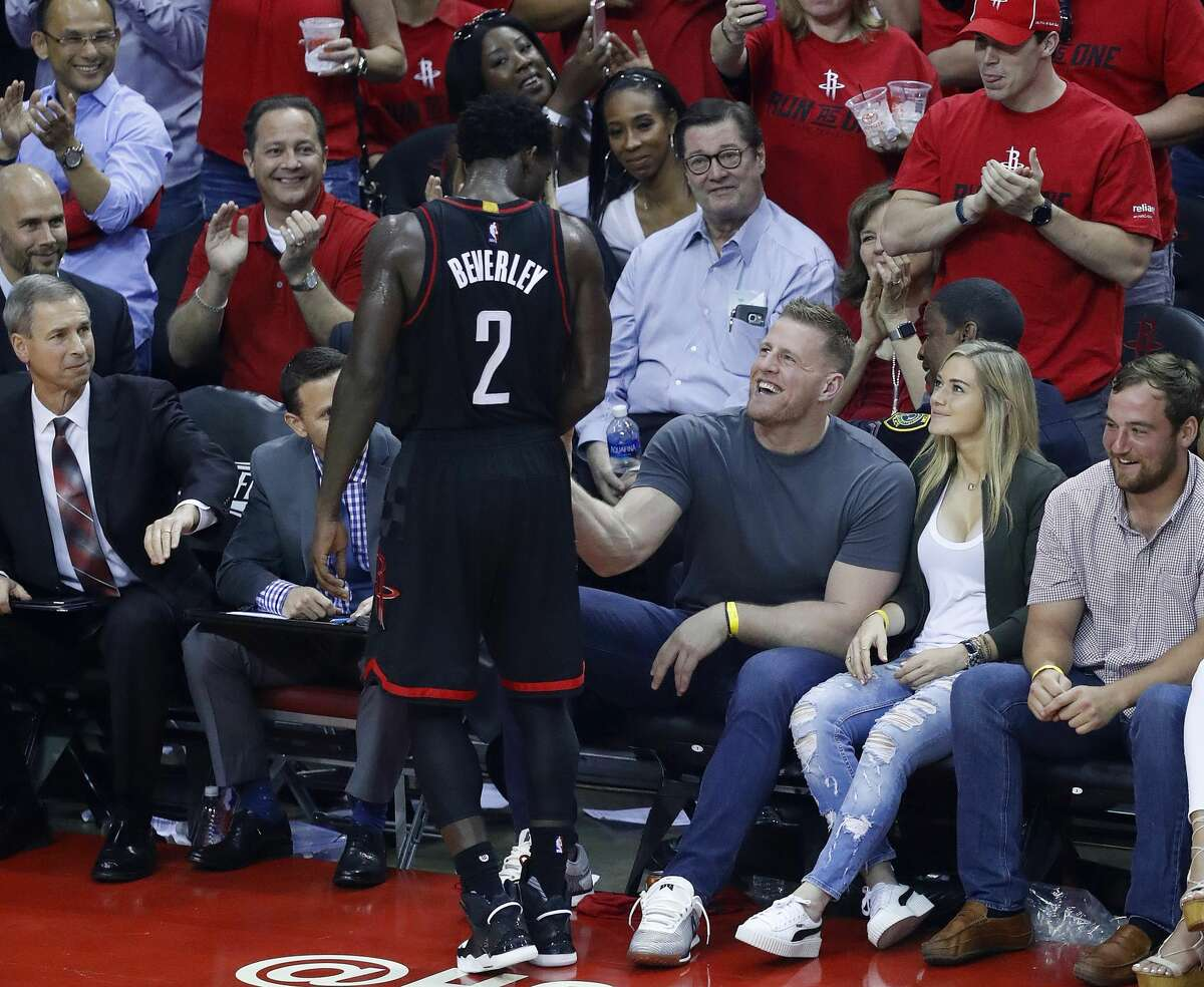 Houston Rockets guard Patrick Beverley (2) talks to Houston Texan JJ Watt after hitting a three pointer during Game 1 of an NBA basketball first-round, Western Conference playoff game at Toyota Center, Sunday, April 16, 2017, in Houston. (Mark Mulligan / Houston Chronicle)