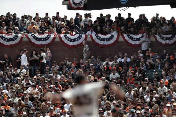 Fans watch Matt Moore pitch as Giants host the Arizona Diamondbacks on Opening Day at AT&T Park.