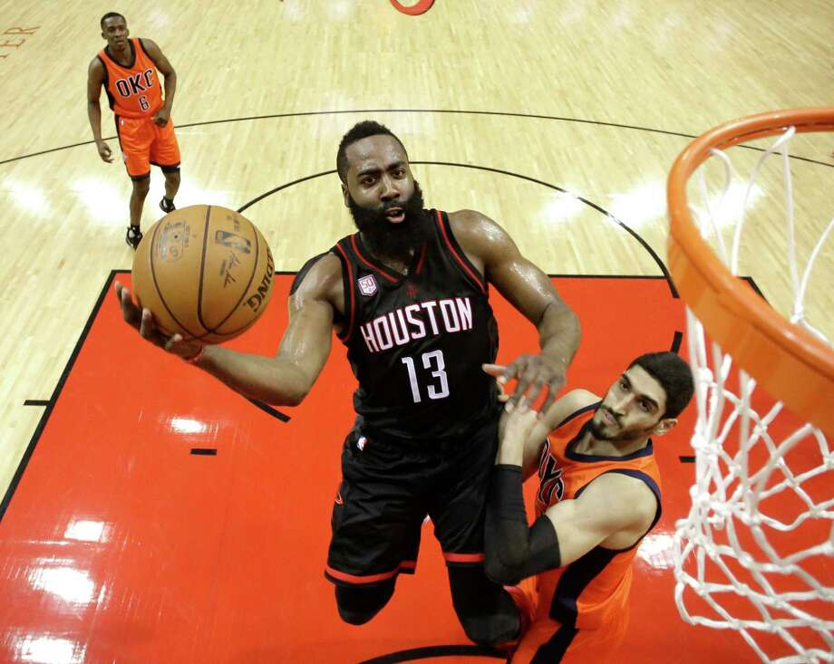 Houston Rockets' James Harden (13) goes up for a shot as Oklahoma City Thunder's Enes Kanter defends during the first half in Game 1 of an NBA basketball first-round playoff series, Sunday, April 16, 2017, in Houston. (AP Photo/David J. Phillip) Photo: David J. Phillip, STF / Copyright 2017 The Associated Press. All rights reserved.