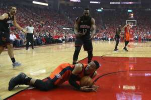 Oklahoma City Thunder guard Russell Westbrook (0) reacts after falling to the ground was Houston Rockets guard James Harden (13) watches during the first half of Game 1 of an NBA basketball first-round, Western Conference playoffs at the Toyota Center, Sunday April 16, 2017, in Houston. ( Karen Warren / Houston Chronicle )