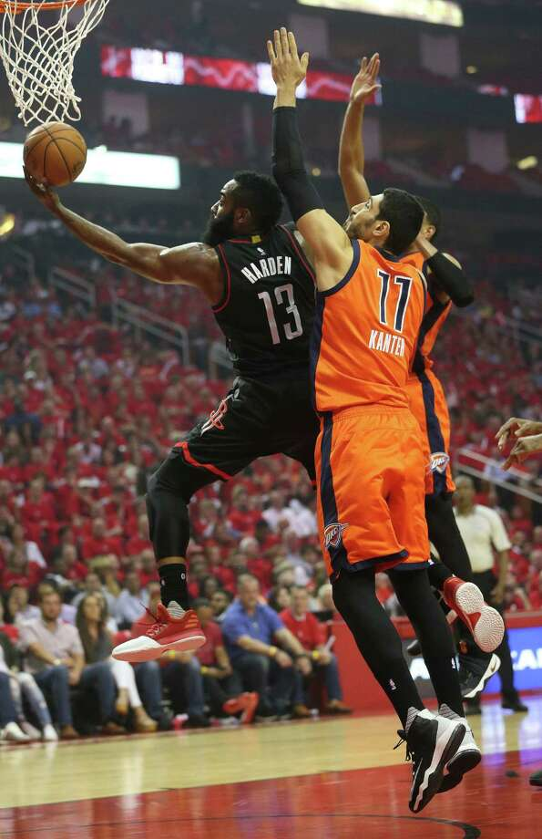 Houston Rockets guard James Harden (13) flies to the basket against Oklahoma City Thunder center Enes Kanter (11) during the first half of Game 1 of an NBA basketball first-round, Western Conference playoffs at the Toyota Center, Sunday April 16, 2017, in Houston. ( Karen Warren / Houston Chronicle ) Photo: Karen Warren, Staff Photographer / 2017 Houston Chronicle