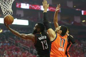Houston Rockets guard James Harden (13) flies to the basket against Oklahoma City Thunder center Enes Kanter (11) during the first half of Game 1 of an NBA basketball first-round, Western Conference playoffs at the Toyota Center, Sunday April 16, 2017, in Houston. ( Karen Warren / Houston Chronicle )