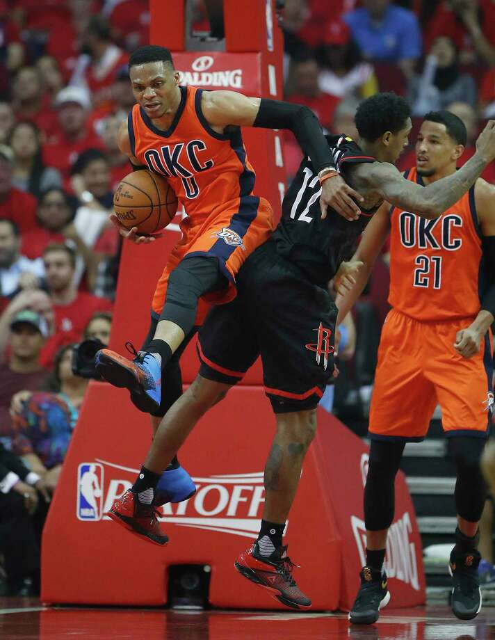 Thunder guard Russell Westbrook (0) pushes aside Rockets guard Lou Williams (12) for a rebound during the second half Sunday night.  Photo: Karen Warren, Staff Photographer / 2017 Houston Chronicle