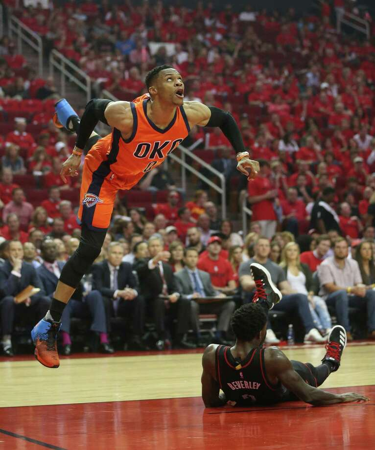 Oklahoma City Thunder guard Russell Westbrook (0) flies over Houston Rockets guard Patrick Beverley (2) for the basket during the second half of Game 1 of an NBA basketball first-round, Western Conference playoffs at the Toyota Center, Sunday April 16, 2017, in Houston. ( Karen Warren / Houston Chronicle ) Photo: Karen Warren, Staff Photographer / 2017 Houston Chronicle