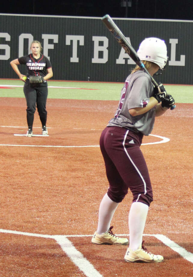 Lady Trojan Hope Ritchie (left) prepares to throw a fastball at a waiting Lady Bulldog. Photo: Jacob McAdams