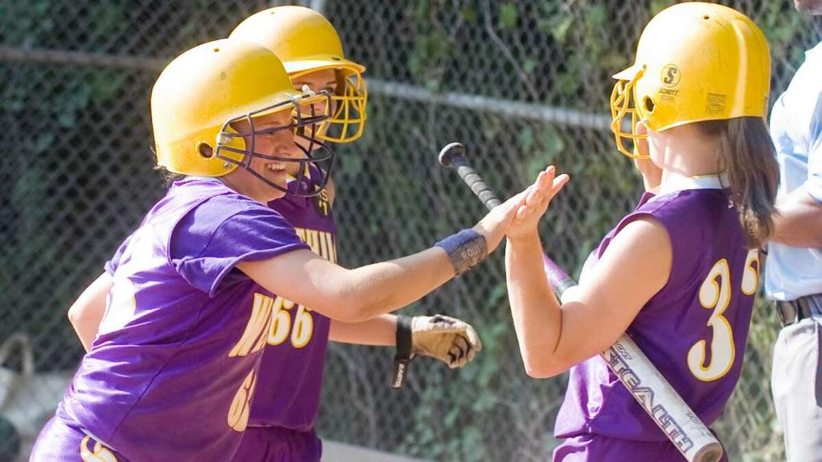 Westhill's Julianne Vincent, right, congratulates Allie Souza, left, and Eileen Tublin after they brought two runs in as Westhill hosts Norwalk High School in a girls Class LL Softball game Thursday, June 3, 2010. Westhill won 8-2.