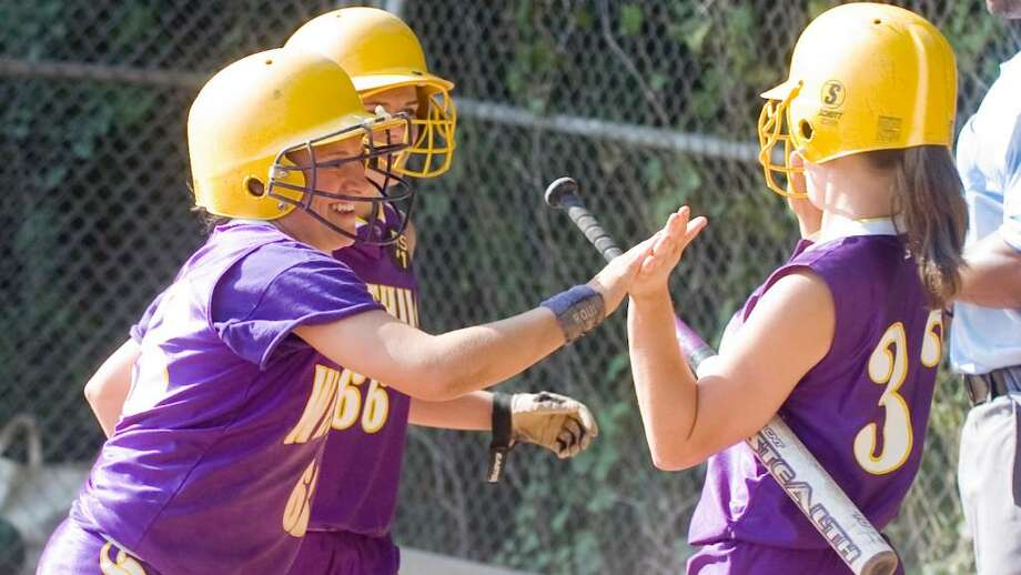 Westhill's Julianne Vincent, right, congratulates Allie Souza, left, and Eileen Tublin after they brought two runs in as Westhill hosts Norwalk High School in a girls Class LL Softball game Thursday, June 3, 2010. Westhill won 8-2. Photo: Keelin Daly / Stamford Advocate