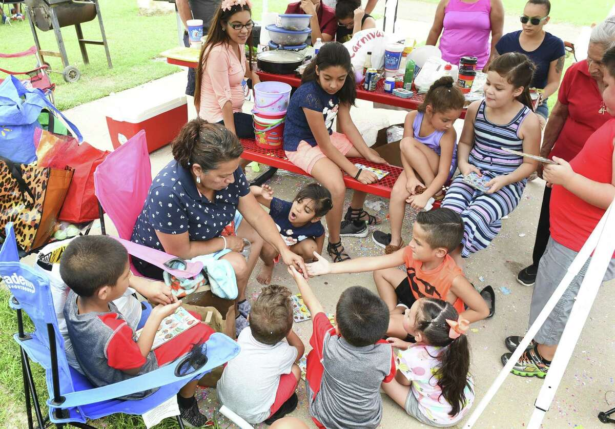 The Medina family celebrate Easter Sunday at the Father Charles M. McNaboe Park as they play a game of Mexican Loteria in this 2017 file photo