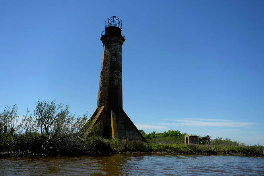 The Sabine Pass Lighthouse stands on the banks of Lighthouse Bayou along Sabine Pass in Cameron Parish, La., Friday, April 7, 2017.  Photo taken Friday 4/7/17 Ryan Pelham/The Enterprise Photo: Ryan Pelham, Ryan Pelham/The Enterprise / ©2017 The Beaumont Enterprise/Ryan Pelham