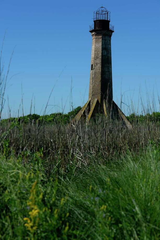 The Sabine Pass Lighthouse stands above Lighthouse Bayou and Sabine Pass in Cameron Parish, La., Friday, April 7, 2017.  Photo taken Friday 4/7/17 Ryan Pelham/The Enterprise Photo: Ryan Pelham, Ryan Pelham/The Enterprise / ©2017 The Beaumont Enterprise/Ryan Pelham