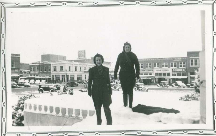 Two ladies stand near the Montgomery County Courthouse in January 1940. Pictured in the background behind them is The Courier office in a building owned by O. Etheridge. The building burned in 1941, but was rebuilt. Today the building houses law offices.
