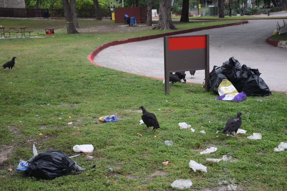 Volunteers and city clean up crews on Monday, April 17, worked to clear trash that people left behind in Brackenridge Park during Easter Weekend.