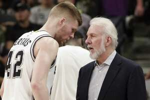 Spurs coach Gregg Popovich talks to rookie forward Davis Bertans during the second half against the Los Angeles Lakers on April 5, 2017, in San Antonio.