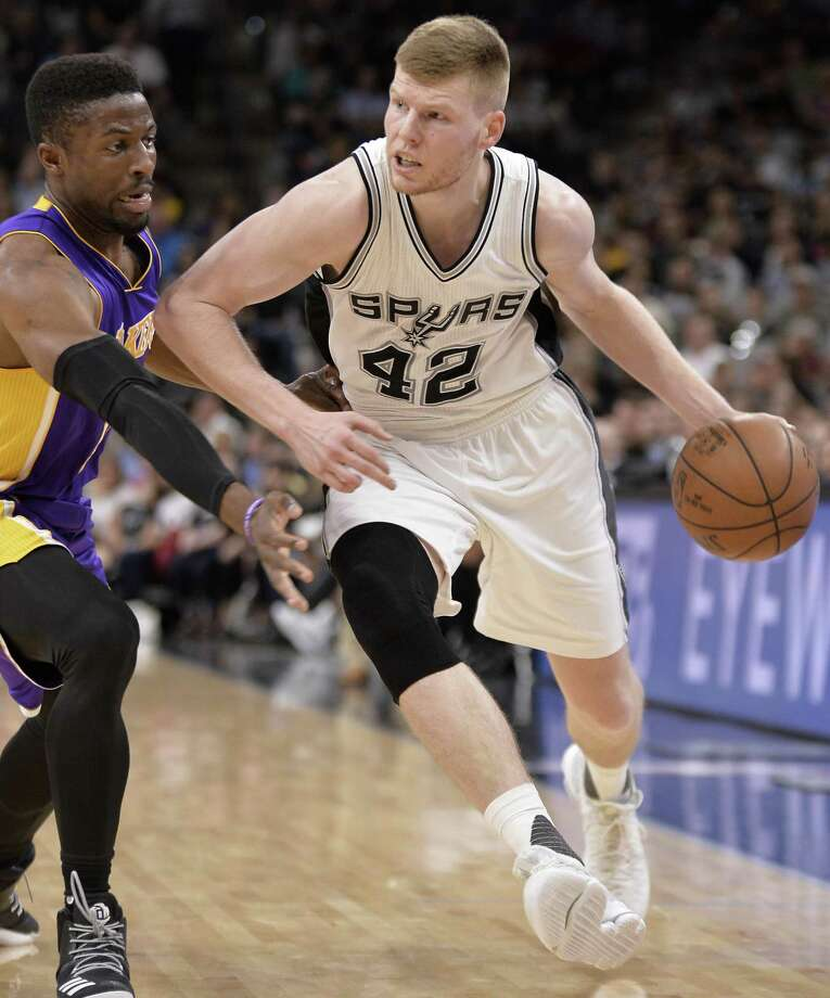 Spurs forward Davis Bertans drives on Los Angeles Lakers guard David Nwaba during the second half on April 5, 2017, in San Antonio. Photo: Darren Abate /Associated Press / FR115 AP