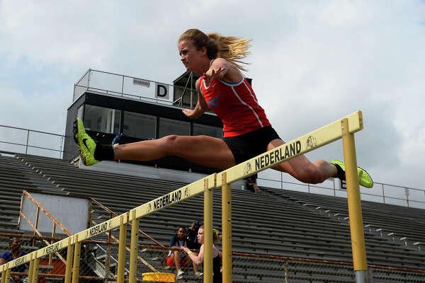 Lumberton sophomore Brittney Yarbro competes in the 100 meter hurdles at the District 22-5A championship track meet at Nederland's Bulldog Stadium on Monday.  Photo taken Monday 4/10/17 Ryan Pelham/The Enterprise