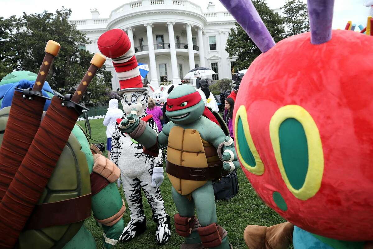 Costumed characters, including the Teenage Mutant Ninja Turtles, the Cat in the Hat and the Very Hungry Caterpillar, participate in the 139th Easter Egg Roll on the South Lawn of the White House April 17, 2017, in Washington, D.C.
