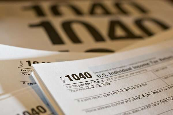 U.S. Department of the Treasury Internal Revenue Service (IRS) 1040 Individual Income Tax forms for the 2016 tax year are arranged for a photograph in Tiskilwa, Illinois, U.S., on Tuesday, March 28, 2017. Due to the Emancipation day holiday, this year's income taxes will need to be filed by April 18 instead of April 15. Photographer: Daniel Acker/Bloomberg