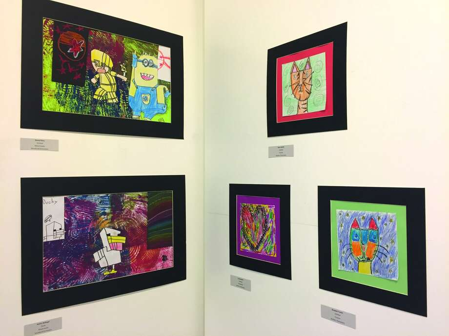 Some of the District 7 student art that is on display in the Edwardsville Arts Center. Photo: Julia Biggs • Intelligencer