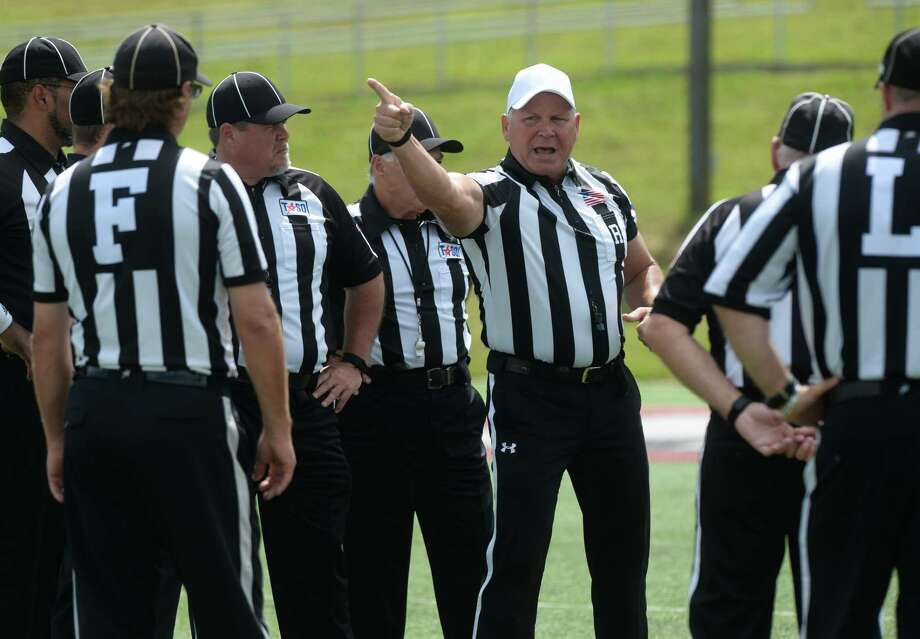 Internet-famed referee Mike Defee chats with other linesmen during Lamar's Red vs. White Spring Game on Friday. Defee was made famous after several pictures highlighting his physical stature flooded the internet after he officiated the 2017 National Championship game in January.    Photo taken Friday, April 14, 2017 Guiseppe Barranco/The Enterprise Photo: Guiseppe Barranco, Photo Editor
