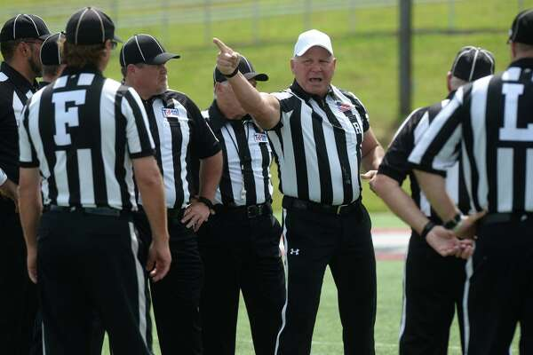 Internet-famed referee Mike Defee chats with other linesmen during Lamar's Red vs. White Spring Game on Friday. Defee was made famous after several pictures highlighting his physical stature flooded the internet after he officiated the 2017 National Championship game in January.    Photo taken Friday, April 14, 2017 Guiseppe Barranco/The Enterprise