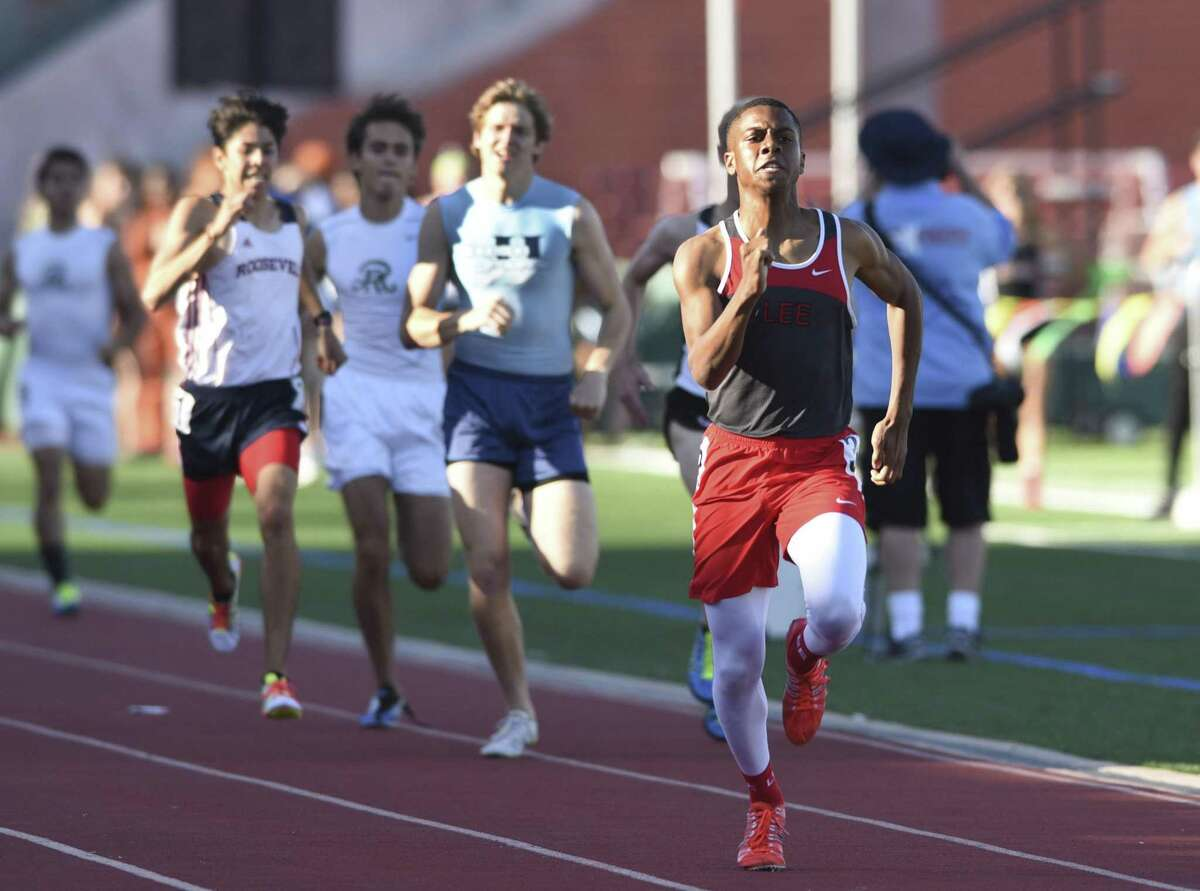 Brandon Falkquay of Lee runs to the finish line during the high school District 26-6A track and field meet at Heroes Stadium on April 14, 2016.