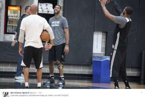 """The  Spurs posted a photo  of Tim Duncan on the court with LaMarcus Aldride Monday morning, April 17, 2017, ahead of the Game 2 clash against the Memphis Grizzlies. """"Look who stopped by shootaround today"""""""