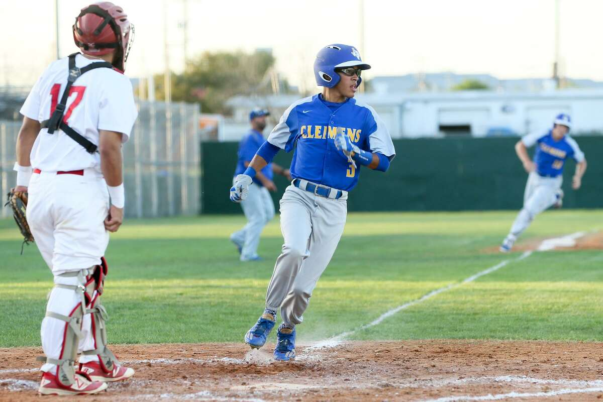 Judson catcher Roland Cantu (left) watches as Clemens' J.J. Esquivel crosses the plate and Peyton McDowall rounds third base during the second inning of their District 27-6A baseball game on March 24, 2017.