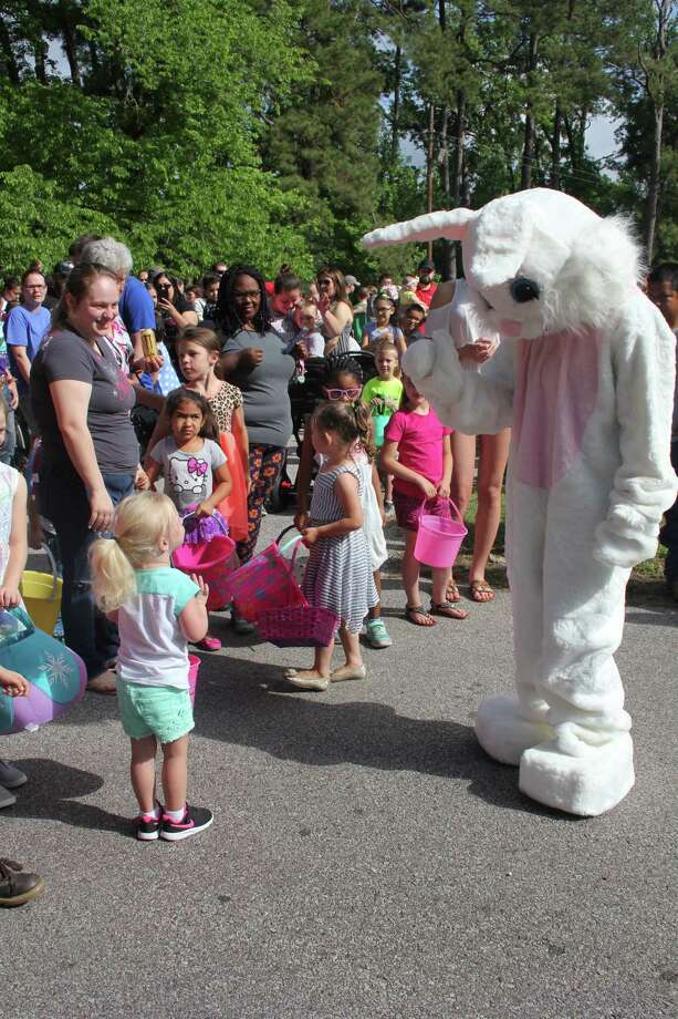 The Easter Bunny greets children at the Seventh Annual Bunny Blast in Cleveland on Saturday, April 17. Hundreds of children and their parents turned out to participate in the free Easter egg hunt. The event is organized by the City of Cleveland and the Unity Committee of Cleveland. Photo: Vanesa Brashier