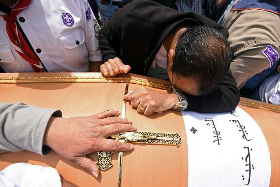 Men mourn over the coffin of one of the victims of the blast at the Coptic Christian Saint Mark's church in Alexandria the previous day during a funeral procession at the Monastery of Marmina in the city of Borg El-Arab, east of Alexandria, on April 10, 2017. Egypt prepared to impose a state of emergency after jihadist bombings killed dozens at two churches in the deadliest attacks in recent memory on the country's Coptic Christian minority. / AFP PHOTO / MOHAMED EL-SHAHEDMOHAMED EL-SHAHED/AFP/Getty Images