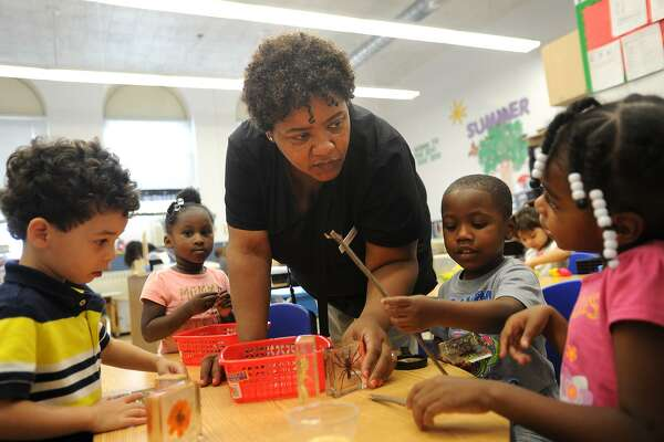 Teacher Terrie Walker, of Bridgeport, works with her students in her preschool classroom at the Bridgeport YMCA Kolbe Education Center on Kossuth Street in Bridgeport, Conn. on Tuesday, June 28, 2016. The Central Connecticut Coast YMCA is in talks to open a new location in Oxford.