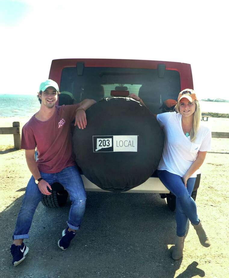 Siblings Tory and Roscoe Brown sit on the back of Roscoe's Jeep at Compo Beach in Westport. The Browns started Two Oh Three, a line of branded gear for lovers of southern Connecticut, in 2014. Photo: Elissa Miolene / For Hearst Connecticut Media / Stamford Advocate Contributed