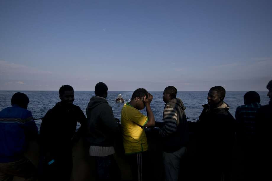 Migrants gather on the stern of the Golfo Azurro on April 7 after being rescued in the Mediterranean by members of Proactiva Open Arms, a Spanish nonprofit organization. Photo: Bernat Armangue, Associated Press