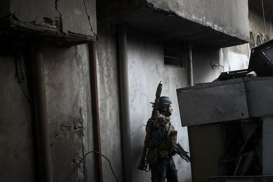 An Iraqi police soldier moves toward the front line during fighting last month against militants in western Mosul. Photo: Felipe Dana, Associated Press